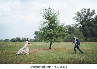 The bride and groom running to each other.