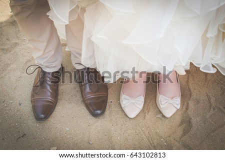 fb092a756 ... Stock Photo (Edit Now) 643102813 - Shutterstock. Bride and groom shoes  on beach sand wedding couple standing next to each other