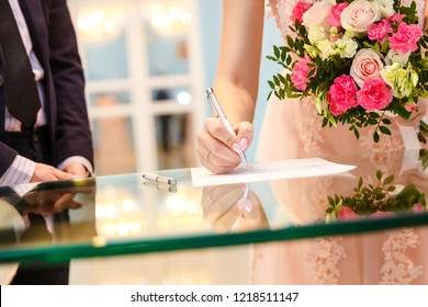 bride and groom sign, solemn registration of marriage