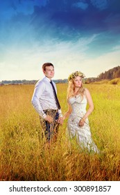 the bride and groom spend time together in nature