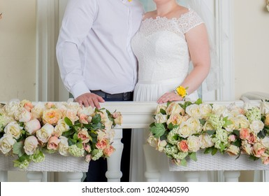 the bride and groom stand on the balcony
