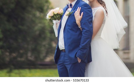 Bride and groom are standing together