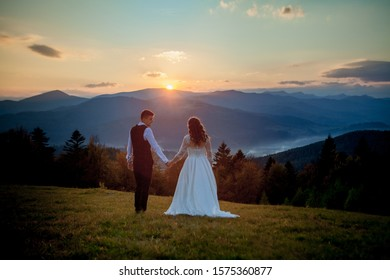 Bride and Groom at Sunset Romantic Married Couple.