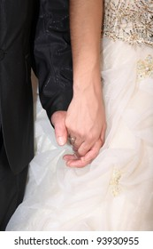 bride and groom at their wedding holding hands