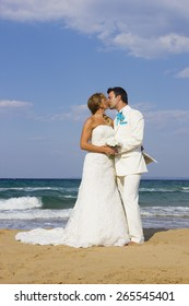 Bride and groom at the tropical beach