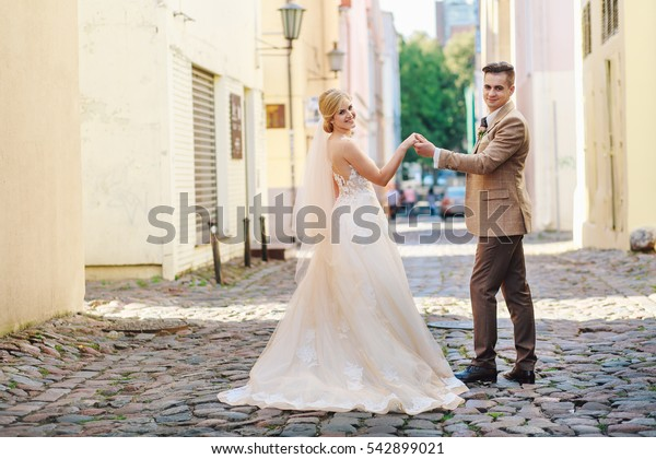 The bride and groom walk around the city. Klaipeda, Lithuania