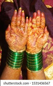 bride groom wearing wedding bangles & mehind desin on her hands front & back side.