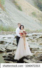 bride and groom. Wedding ceremony near a mountain river