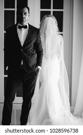 Bride and groom at the wedding Day. Wedding couple, happy newlywed woman and man, in a beautiful hotel room, studio. Loving couple. Bride and groom