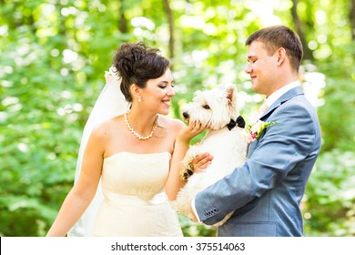 Bride and groom wedding with dog summer outdoor