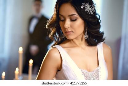 Bride and groom - wedding elegant photo. Bride in a luxury white wedding dress holding bouquet