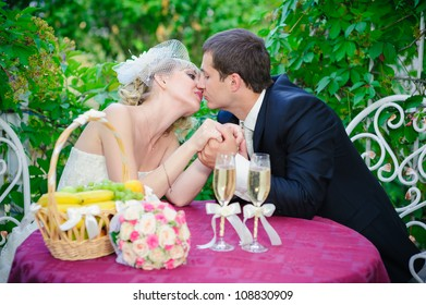 bride and groom. wedding. summer street cafe. champagne glasses.
