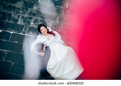 Bride in the groom's arms