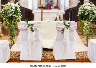 Church decoration images stock photos vectors shutterstock the bride and grooms chairs inside of the church junglespirit Gallery