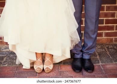 Bride and groom's feet on wedding day
