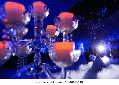 The bride and groom's first dance, surrounded by candles