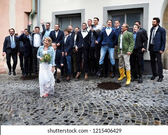 Bride with groomsmen. Wedding in rubber boots. Gumpoldskirchen in Lower Austria. Austria, Europe, September 2018.