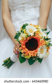 Bride in hands holds a bouquet of flowers