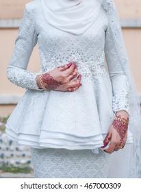 Bride with henna ( malay dress songket )