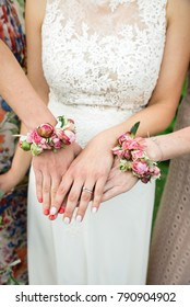 Bride and her bridemaids showing her hands decorated with pink flowers