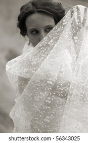 Bride hidden by the wedding veil