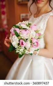 Bride holding a bouquet of flowers, wedding bouquet