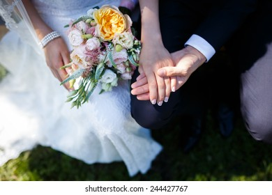 Bride holding bouquet with your groom in wedding day
