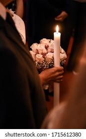 Bride holding Candle on greek weeding