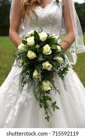 Bride holding cascading bridal bouquet