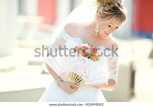 Bride Holding Fan Wedding Bouquet Outdoors Stock Photo (Edit