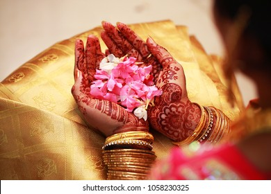bride holding flower, Indian wedding ceremony