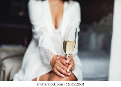 Bride holding a glass of champagne.  Close up picture