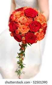 Bride holding orange bouquet isolated on white