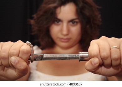 Bride holding a small elegant knife, focus on the knife
