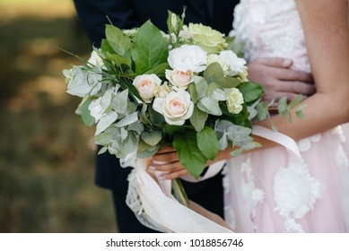 The bride is holding a stunning wedding bouquet. Wedding, flowers.
