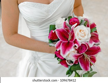 Bride holding wedding bouquet.