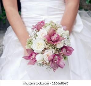 Bride holding wedding bouquet