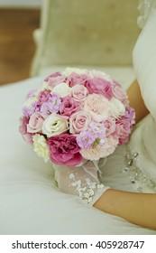 A bride holding a wedding bouquet