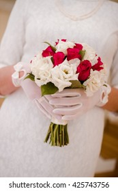 The bride holding a wedding bouquet.