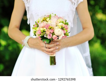 Bride holding wedding bouquet - close up