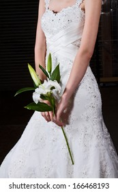 Bride Holding White Lily In Stunning Bridal Gown
