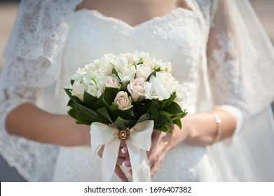 bride holds a bouquet in her hands.  close-up on a bouquet