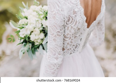 Photo of Bride holds a wedding bouquet, wedding dress, wedding details