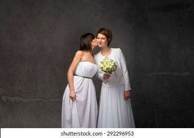 bride kissing, dark background