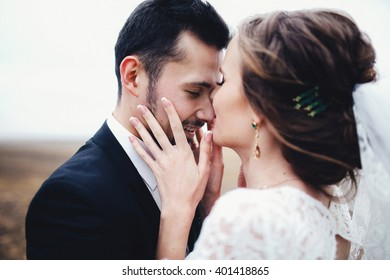 Bride is kissing the groom's nose