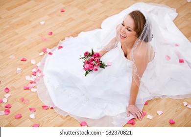 Bride: Laughing Bride on Floor with Flower Petals