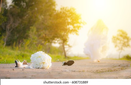 bride leave bouquet and shoes on road run away