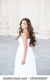 Bride with long dark hair in white dress