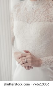 bride looked at the ring while waiting for groom.