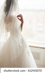 Bride looks out of the window,wedding day